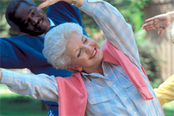 Photo of two seniors exercising