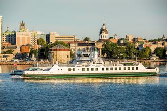 Wolfe Islander III travelling on Lake Ontario with downtown Kingston in the background