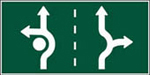 Choose the correct lane based on which direction you want to go. Keep to the right of the Central Island.