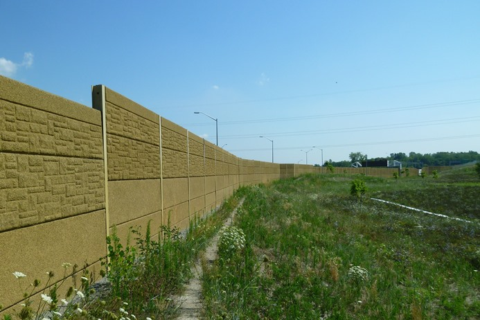 Photo O: The smooth lower panels of this noise barrier wall prevent Eastern Foxsnakes from accessing the highway.