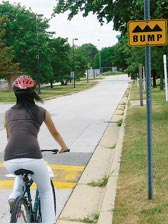 cyclist approaching a speed bump