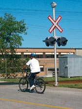 cyclist approaching railway crossing