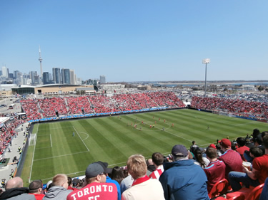 Fans watch a game at BMO field. Photo credit: Mark Walmough