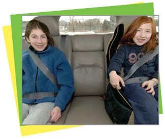 Photo of a youth a seat belt and a child in a booster seat