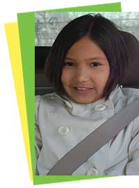 Photo of a girl harnessed in a seat belt