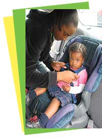 Mother-Harnessing Child in Car Seat