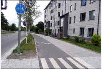 Dedicated bike lanes adjacent to sidewalks such as this Stockholm example create a safer environment for cyclists and facilitate plowing during winter months.