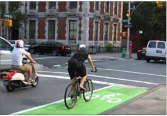 Painted, curb-side bike lanes such as this example from New York create a highly visible space for cyclists along busy streets.