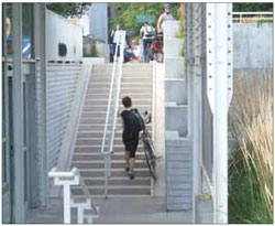 Where stairs exist, the use of bike ramps, such as this one at Millennium Park Bicycle Station in Chicago, can help to facilitate access for cyclists.