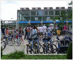 Bike rental facilities and repair shops integrated into larger transit centres, such as this one in Millennium Park, Chicago, help to encourage passengers commuting to transit stations to cycle and can help departing passengers reach local destinations.