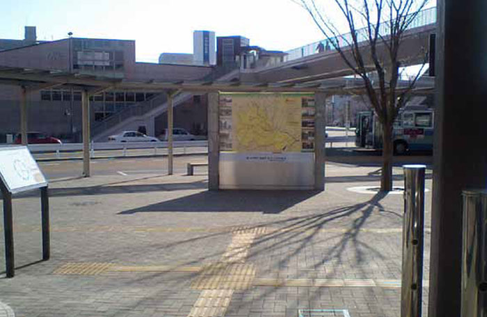 The paving and signage at a bus station in Tokyo are used together to direct both seeing and visually impaired passengers between the various parts of the station.