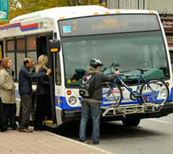 Providing bike racks on buses such as in this example from Brampton can enable cyclists to travel longer distances and journey from the stop to their destination.