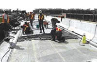 Photo of workers placing cathodic protection system