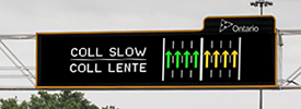 Electronic highway sign indicating traffic flow on express and collector lanes