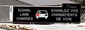 Electronic highway sign telling drivers to signal lane changes