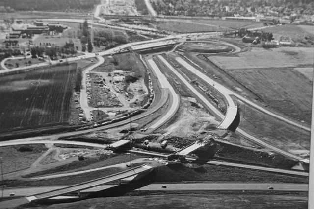 Construction of the Highway 416 and Highway 417 interchange, 1996. <br> Image from MTO's collection.
