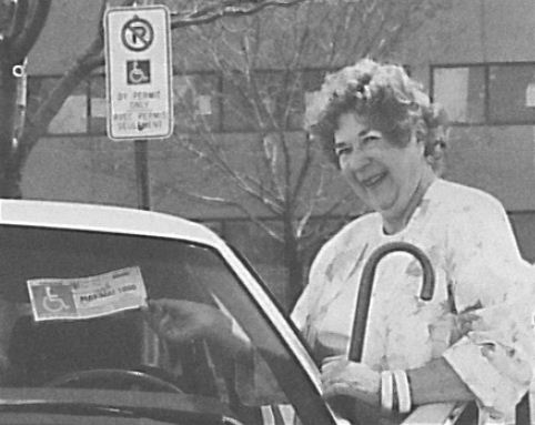Driver uses an accessible parking permit, date unknown. © Rick Radell.