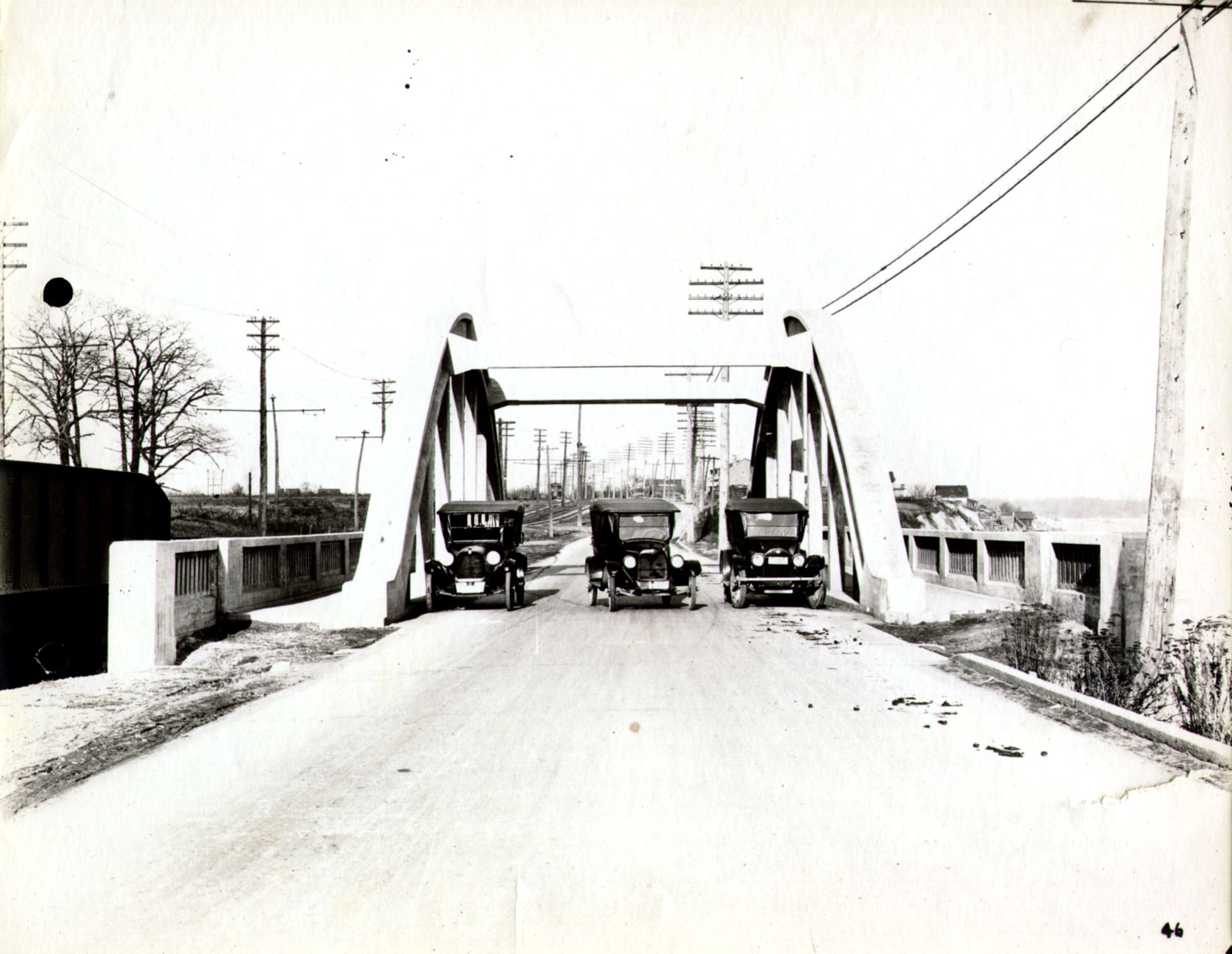 Cars on a bridge in Oakville, 1923. <br> Image from MTO's collection.