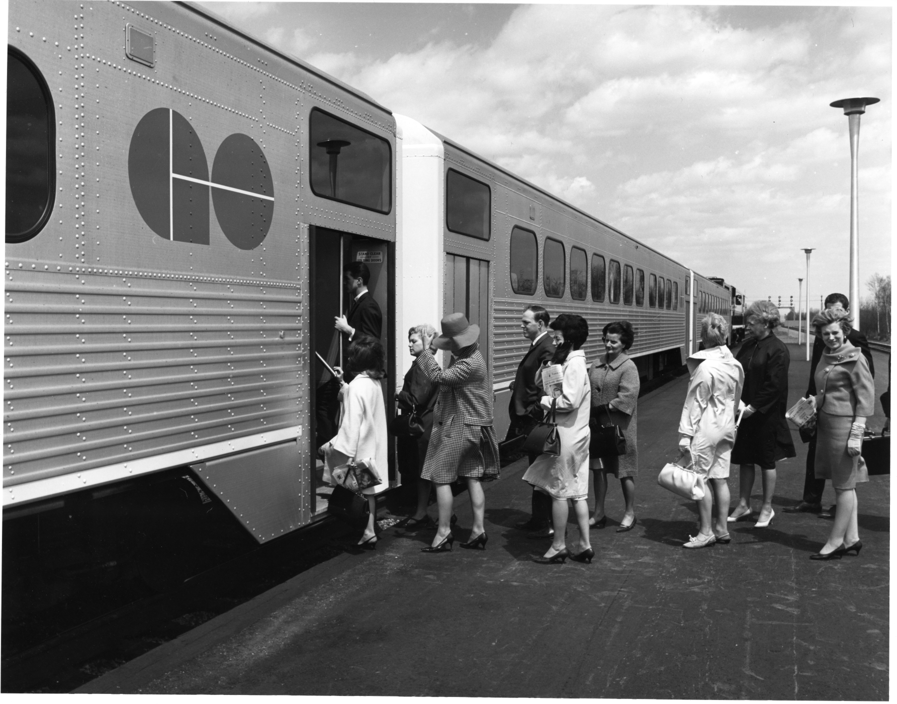 Passengers participate in a GO Transit train test run, 1967. <br> Image from MTO's collection.