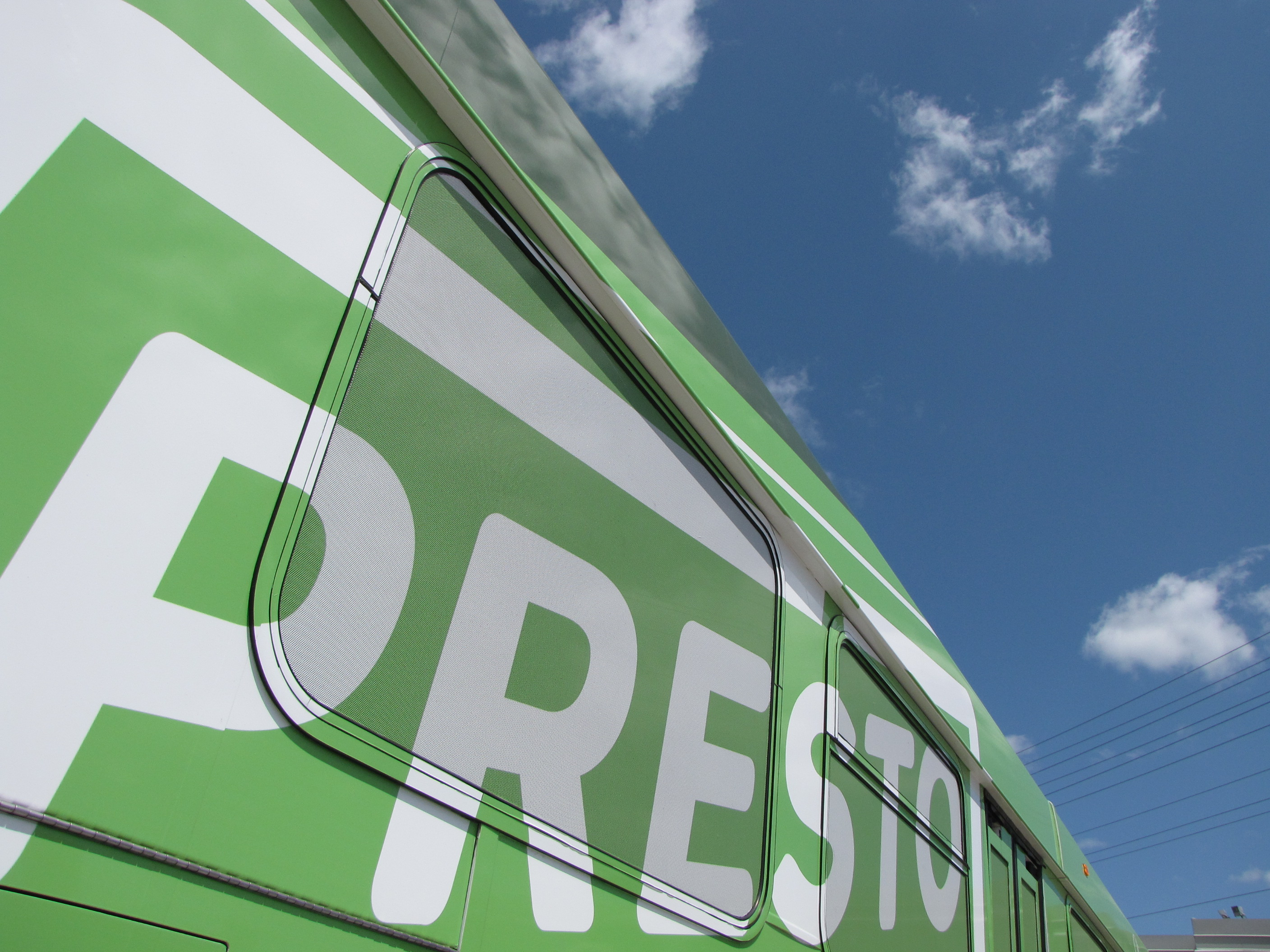 Presto logo on the side of a bus, date unknown. <br> Image from MTO's collection.