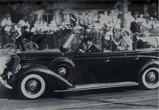 King George VI and Queen Elizabeth at the official Queen Elizabeth Way dedication ceremony in St. Catharines, 1939. <br> Image from MTO's collection.