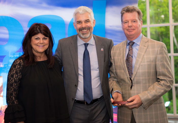 Heidi Francis with Stephen Rhodes and Divisional Partnership Award 
