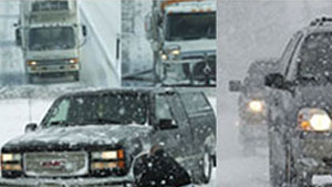 Cars and trucks driving on snow packed roads during winter storm